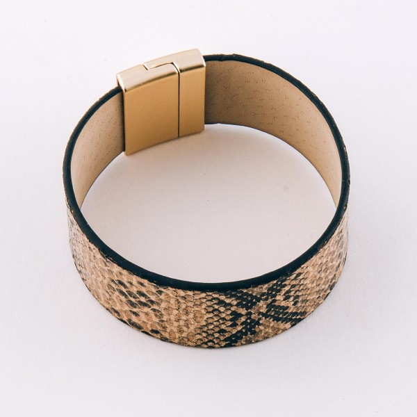 """Faux leather snakeskin magnetic bracelet.  - Magnetic closure - Approximately 3"""" in diameter - Fits up to a 7"""" wrist - Approximately 1"""" wide"""