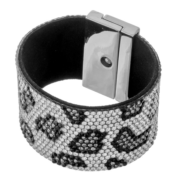 """Faux leather rhinestone leopard print turn lock bracelet.  - Turn Lock closure - Approximately 3"""" in diameter - Fits up to a 6"""" wrist - Approximately 1.5"""" wide"""