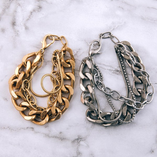 """Chunky multi strand curb chain link bracelet.  - Lobster clasp - Adjustable 1"""" extender - Approximately 3"""" in diameter - Fits up to an 8"""" extender"""