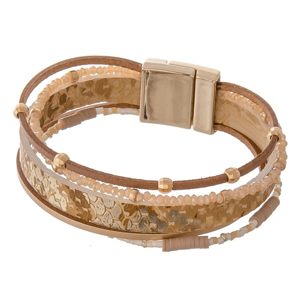 """Metallic faux leather snakeskin beaded magnetic bracelet.  - Magnetic closure - Approximately 3"""" in diameter - Fits up to a 6"""" wrist"""