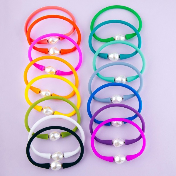 "Pearl silicone flex stretch bracelet.  - Approximately 3"" in diameter - Fits up to a 7"" wrist"