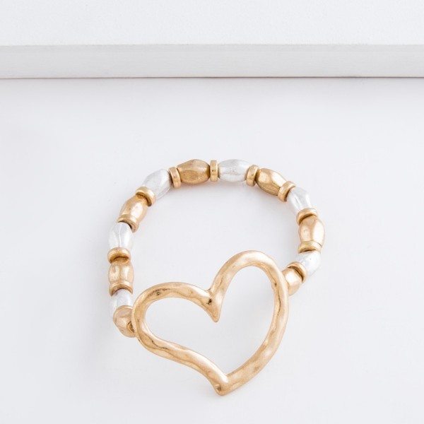 """Worn two tone hammered beaded heart stretch bracelet.  - Focal approximately 1.5""""  - Approximately 3"""" in diameter unstretched - Fits up to a 7"""" wrist"""