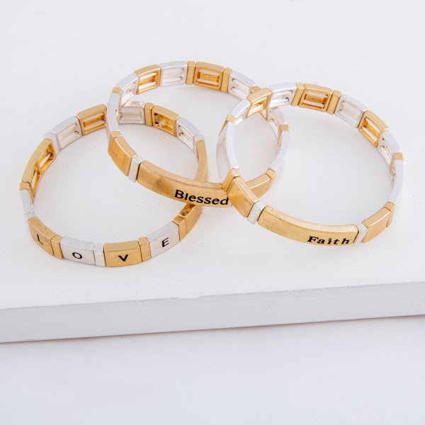 """Worn two tone """"Faith"""" stamped block stretch bracelet.  - Approximately 3"""" in diameter unstretched - Fits up to a 7"""" wrist"""