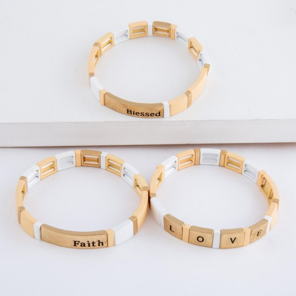 """Worn two tone """"Love""""stamped block stretch bracelet.  - Approximately 3"""" in diameter unstretched - Fits up to a 7"""" wrist"""