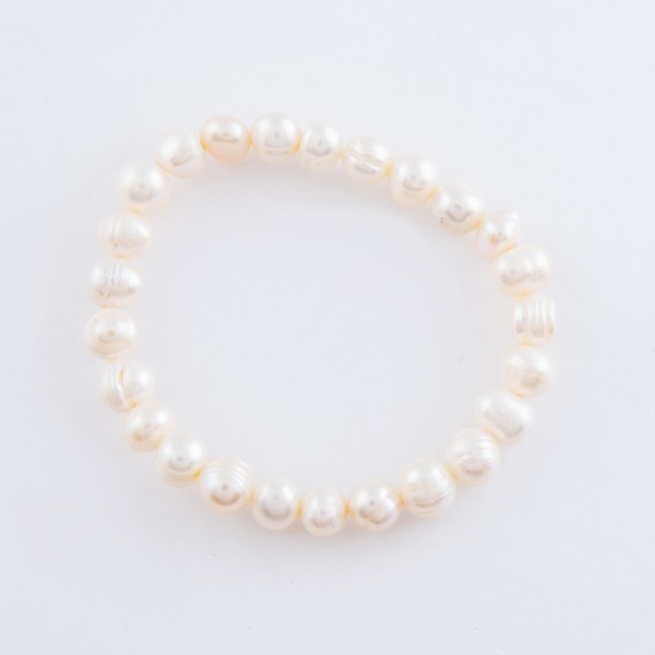 "Freshwater pearl beaded stretch bracelet.  - Approximately 3"" in diameter unstretched - Fits up to a 7"" wrist"
