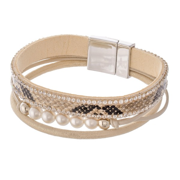 "Pearl beaded faux leather snakeskin magnetic bracelet with rhinestone details.  - Magnetic closure - Approximately 3"" in diameter - Fits up to a 6"" wrist"