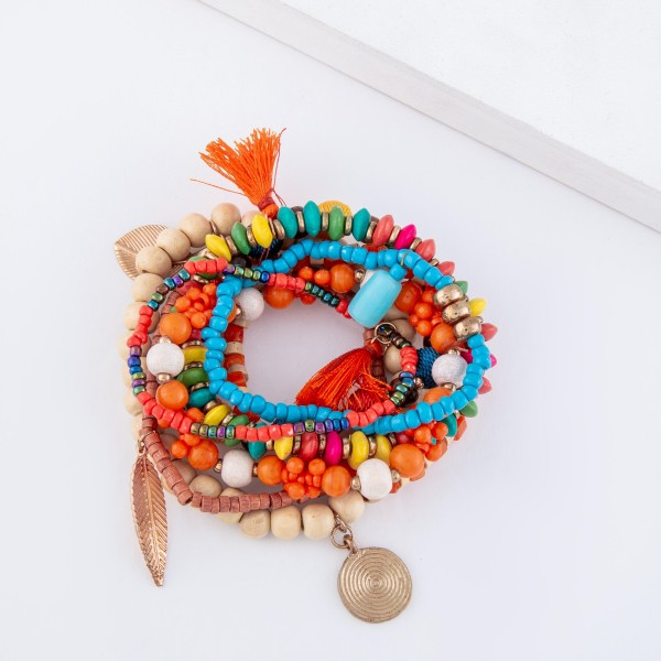 "Multicolor Wooden Beaded Boho Charm Stretch Bracelet Set with Tassel and Thread Wrapped Accents.  - 8pcs/set - Approximately 3"" in daimeter unstretched - Fits up to a 7"" wrist"