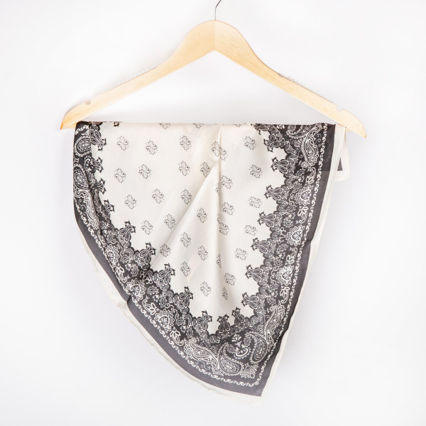 "Black with white paisley neckerchief. 100% polyester. Approximate 28x28"" in length."
