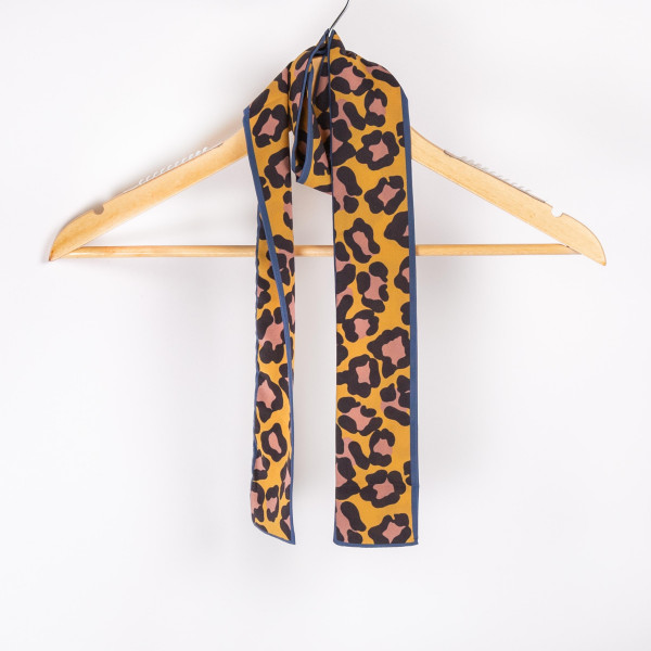 "Brow leopard with blue trim scarf. 100% polyester. Approximate 46"" in length."