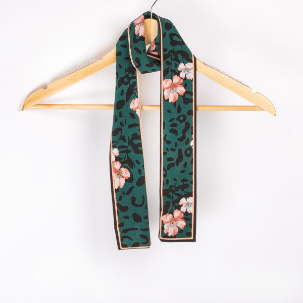"Green leopard with floral neck scarf. 100% polyester. Approximate 46"" in length."