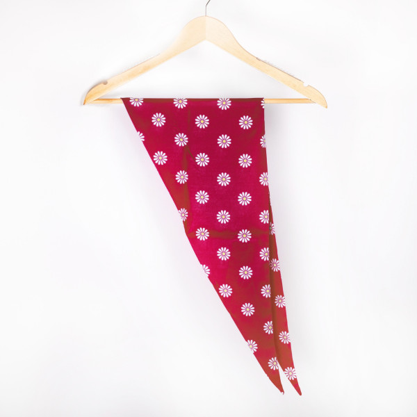 "Daisy triangle scarf. 100% polyester. 46"" in length."