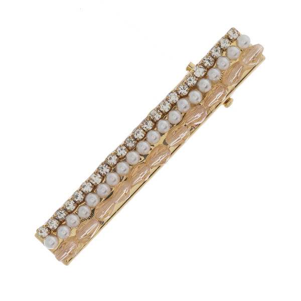 "Gold hinge closure hair barrette featuring iridescent beads and faux pearl accents with cubic zirconia details. Approximately 2"" in length."