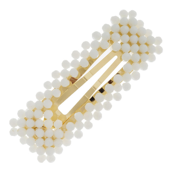"""Hair clip featuring iridescent bead details. Approximately 3"""" in length."""