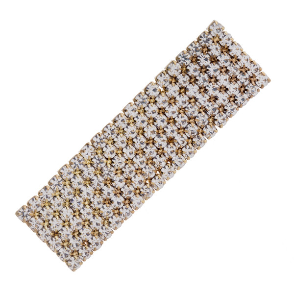 "Gold hair clip featuring cubic zirconia details. Approximately 2.25"" in length."
