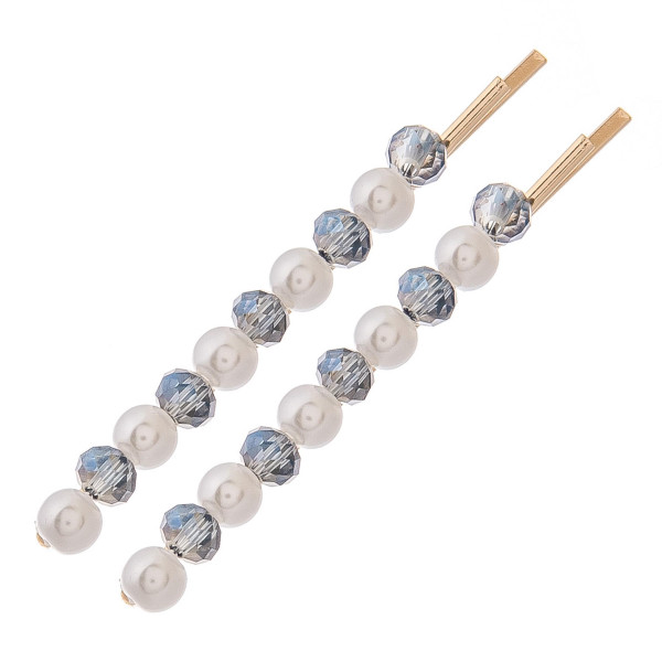 "Hair pin set featuring faceted and pearl beaded details. Two pins per pack. Approximately 2.5"" in length."