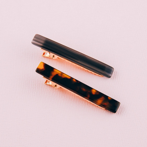 "Hair clip featuring resin inspired details. Approximately 2"" in length."