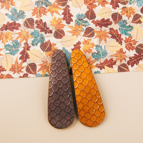"Faux leather snakeskin hair clip. Approximately 3"" in length."