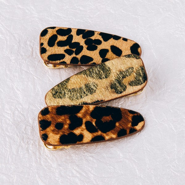 "Faux fur leopard print hair clip. Approximately 2.5"" in length."