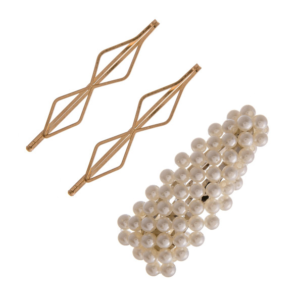 """Hair pin set featuring:   - 1 pearl beaded clip - 2 geometric metal pins  Approximately 2.5"""" in length."""