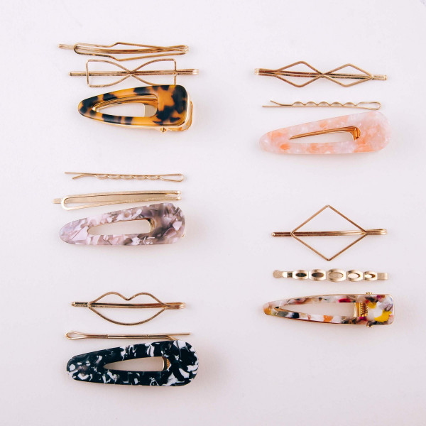 "Hair pin set featuring:   - 1 resin marble hair clip - 2 geometric hair pins  Approximately 2.5"" in length."