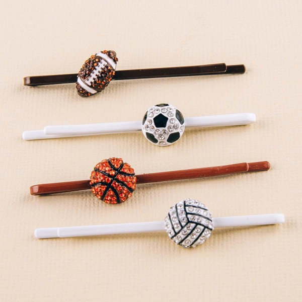 "Rhinestone soccer ball enamel coated hair pin set. Features two pins. Approximately 2.5"" in length."