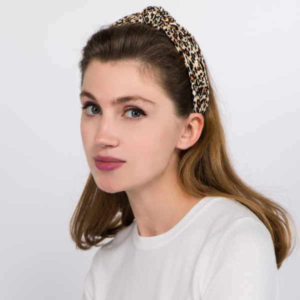 Leopard print pleated knotted headband.  - One size fits most - 100% Polyester