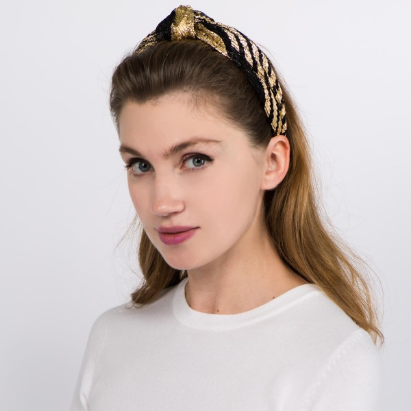 Gold metallic lace knotted headband.  - One size fits most  - 100% Polyester