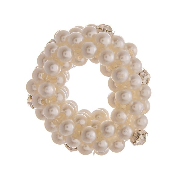 "Medium size pearl beaded rhinestone stretch rope scrunchie ponytail hair accessory. Approximately 1.5"" in diameter."