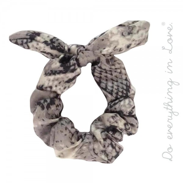 Do everything in Love brand snakeskin bow scrunchie.  - One size - 100% Polyester