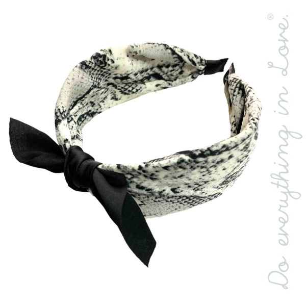 Do everything in Love brand snakeskin bow headband.  - One size fits most - 100% Polyester