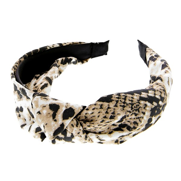 Snakeskin knotted headband.  - One size fits most  - 100% Polyester