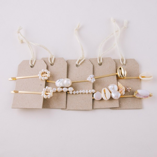 "Faux pearl hair pin set of two.  - Pearls vary in size - Approximately 2.5"" in length"
