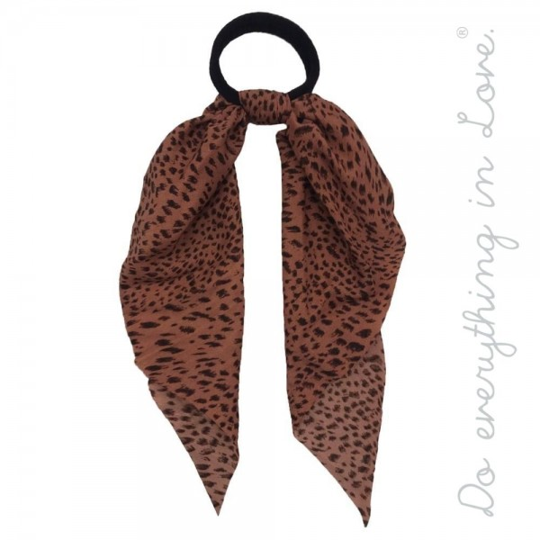 "Do everything in Love brand leopard print ponytail scarf.  - One size - Approximately 12"" L - 100% Polyester"