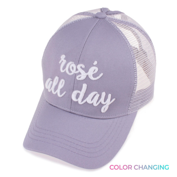 C.C Brand BT-10 ponytail baseball cap with embroidered lettering that changes color in the sun.    • PonyCap style • 60% cotton 40% polyester • Adjustable velcro back  • One size fits most