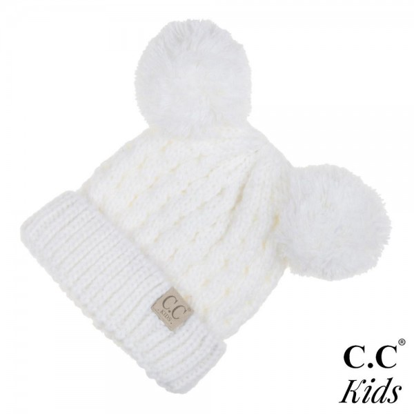 """KID-24: Chunky cable knit C.C Beanie with double pom. 100% acrylic. Measures 7"""" in diameter and 8"""" in length. Approximate fit: 4 to 7 years of age."""