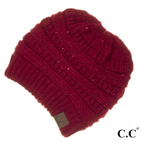 "MB-730: Cable knit messy bun C.C beanie style with sequin accents. 100% acrylic. Measures 9.5"" in diameter and 8"" in length."