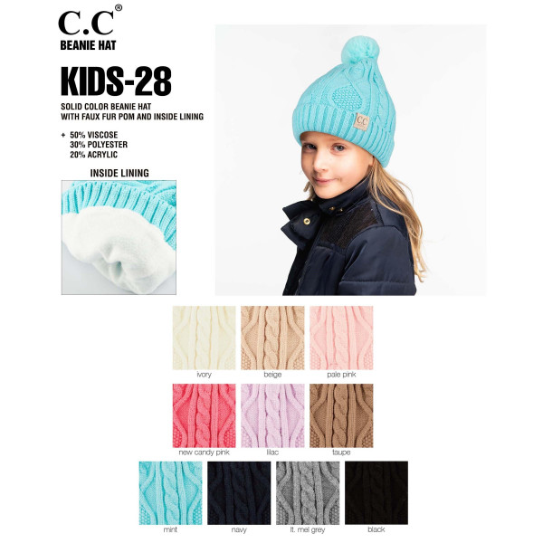 """KID-28: Chunky cable knit C.C Beanie with pom-pom. 50% Viscose, 30% Polyester, 20% Acrylic. Measures 7"""" in diameter and 8"""" in length. Approximate fit: 4 to 7 years of age."""