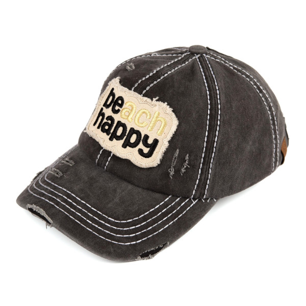 """Ponytail baseball cap that reads, """"Beach Happy.""""   -Vintage-washed -Distressed fabric -100% cotton -One size fits most"""