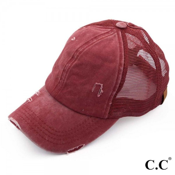 C.C BT-13 burundy distressed vintage style ponytail cap. Mesh back and velcro closure. 100% Cotton. One size fits most.