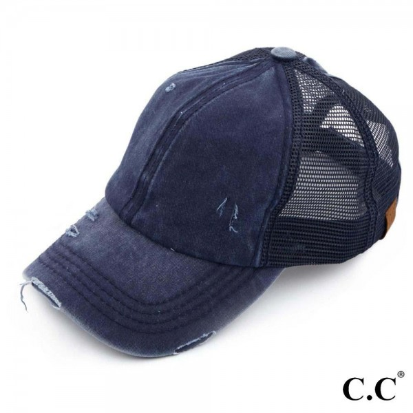 C.C BT-13 navy distressed vintage style ponytail cap. Mesh back and velcro closure. 100% Cotton. One size fits most.