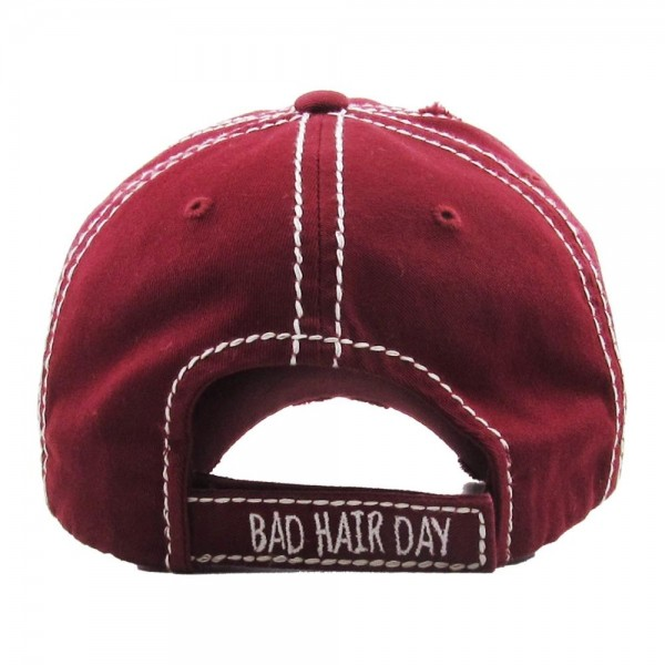 "Vintage, distressed baseball cap featuring ""Bad Hair Day"" embroidered detail.  - One size fits most  - Adjustable velcro closure - 100% Cotton"