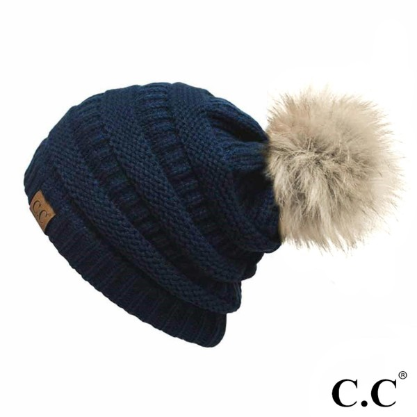 Cable knit, original C.C beanie with a faux fur pom pom, in navy. 100% acrylic.