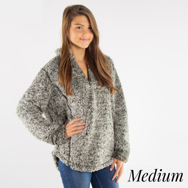 Lined faux sherpa pullover. Quarter zip. Color dye may vary slightly per size. 100% polyester.