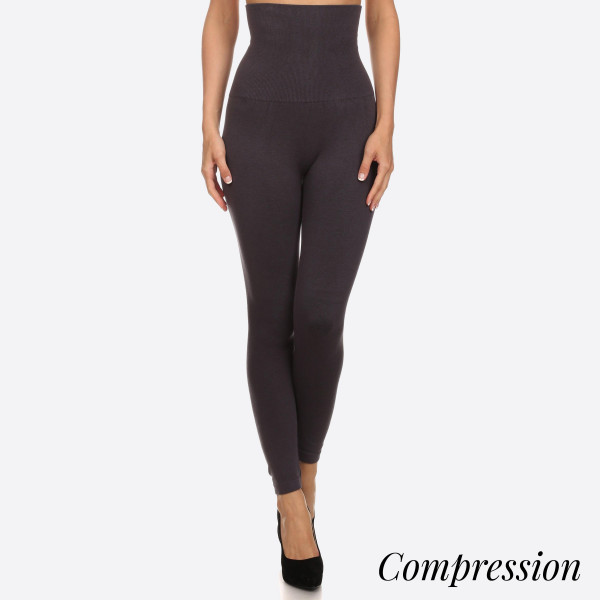 "High Waist Compression Leggings. Tummy Control for extra hold. These high waist leggings have a compression control top that flattens your tummy and contours your waistline for an hourglass silhouette.   - Long, skinny leg design  - Does not ball or pill  - Comfortable and easy pull-on style  - Solid color  - Very Stretchy   - Tummy Control  - Hight Waist  - 8"" Waist Band, 37"" Full Length   One size fits most 0-14.  Content: 55% viscose, 40% polyester, 5% spandex"