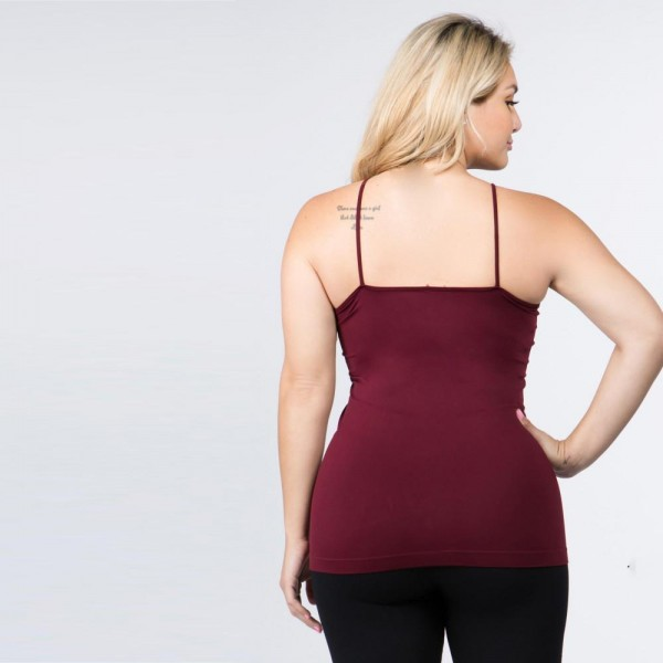 The summer must-have is here! This sexy cami top features spaghetti straps, sleeveless design, and a crisscross front. Wear this top with distressed shorts and take on summer in style! One size fits most plus 16-22.   - Scoop-neck  - Solid Color - Unique Crisscross Front  - Spaghetti Straps  - Ultra Soft  - Stretchy Knit  - Machine Wash  - Imported   Content: 92% Nylon, 8% Spandex.