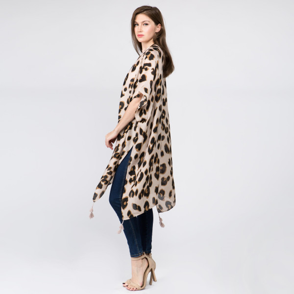 Lightweight animal print kimono and tassels. One size fits most 0-14. 100% polyester.
