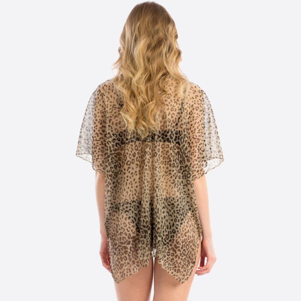 Leopard print cover up.  31.4x51 100% POLYESTER.