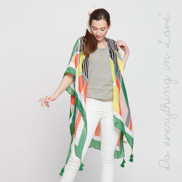 Multi colored geometric kimono. 100% polyester.