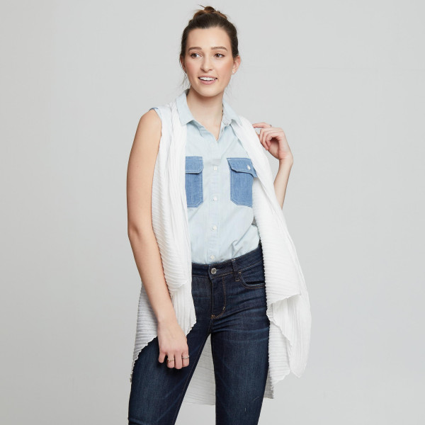 Pleated vest. 70% Polyester, 30% Cotton. One size fits most 0-14.