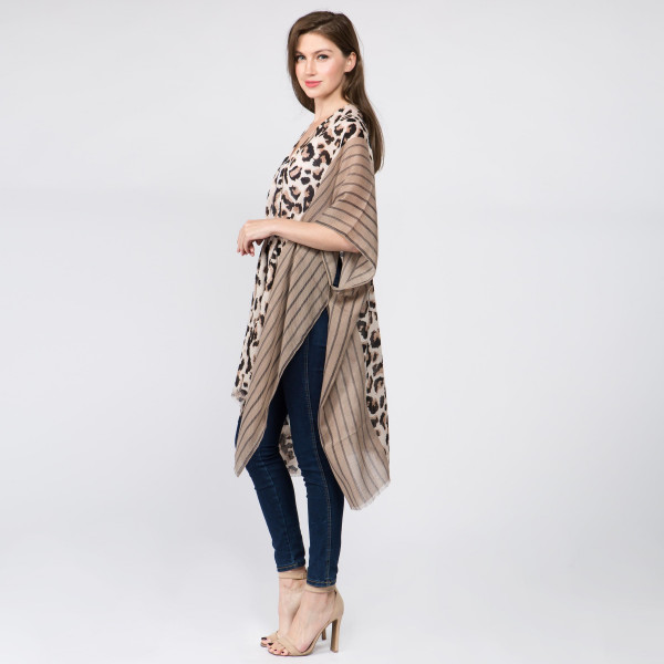 Leopard print kimono. 100% polyester. One size fits most 0-14.
